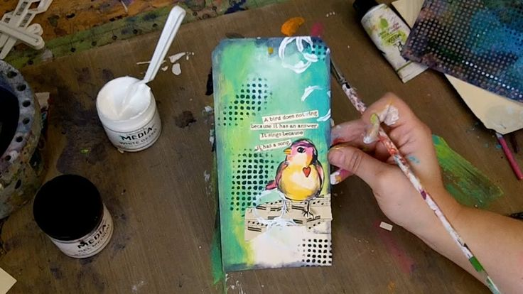 Join Dina Wakley in her studio as she shares some techniques using her new acrylic paints while creating this fun tag!