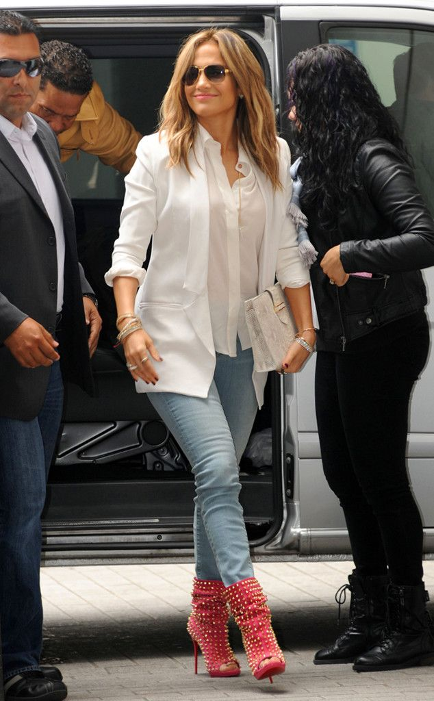 Casual Studs from Celebrity Street Style Jennifer Lopez— on a press tour in London sporting a white silk shirt, blazer and light denim— takes the casual look to a new level with sky-high, pink studded booties by celebrity fave Christian Louboutin.