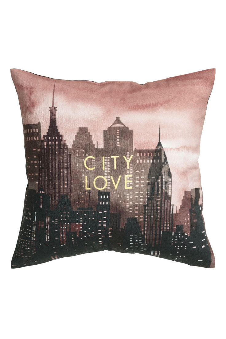 Pink/black. Cushion cover in cotton twill with a printed motif at front and solid color at back. Concealed zip.