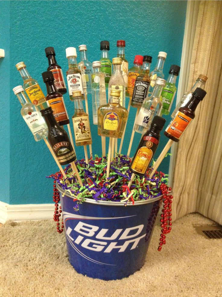 21st Birthday Bouquet:  Made something like this for my boyfriends 21st birthday. He loved it, I had about 25 different bottles on chopsticks. Stick foam on the bottom, with tape, and put something on top to conceal the foam.