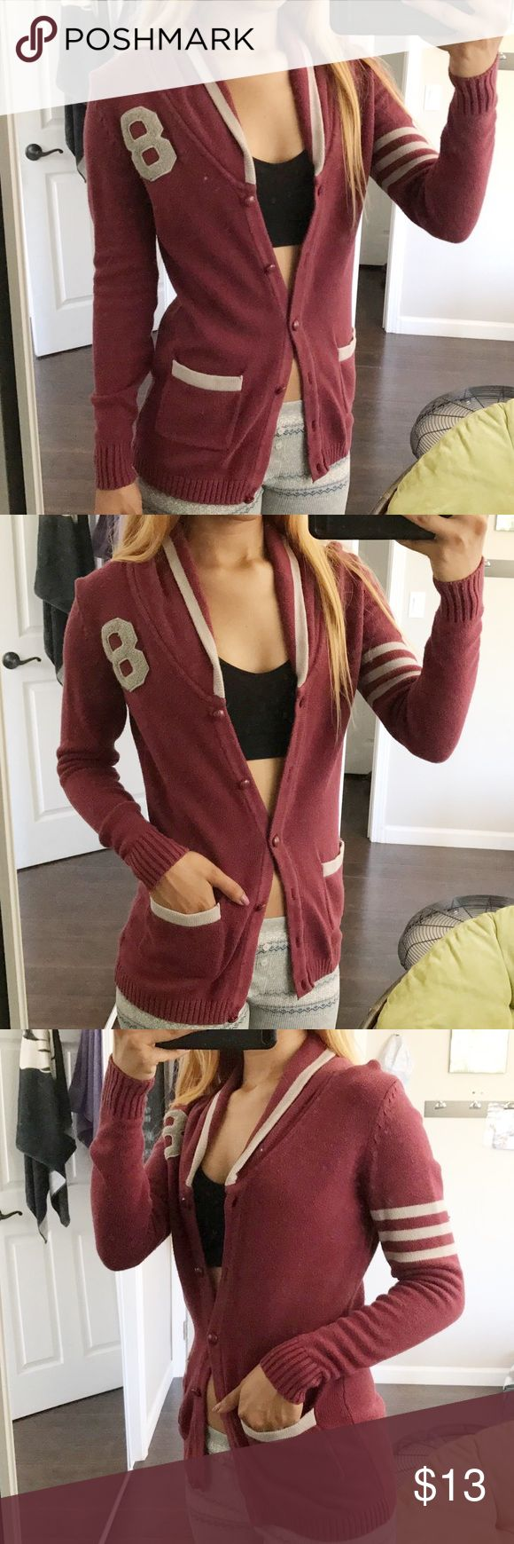 F21 Letterman Cardigan✨ SIZE SMALL💫 Burgundy Letterman Cardigan✨Perfect outdoor cardigan & comfortable! It's a thick material that will keep you warm! It has two small front pockets & on the right sleeve it has three grey lines & top front left of the cardigan it has the number 8 sewn in. I love the neck line of it! The color of the cardigan is a bit worn out but It's a great piece for the fall✨ Forever 21 Sweaters Cardigans