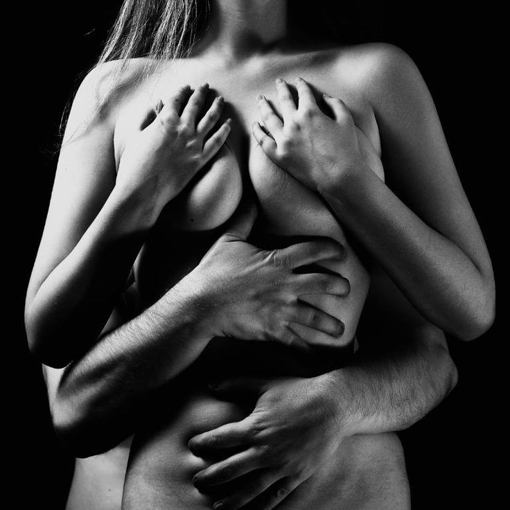 Cropped view of shirtless man hugging sensual naked woman, isolated on beige