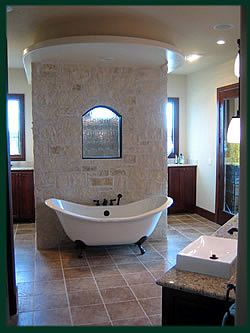 slipper tub - but with a walk in shower behind the wall ...