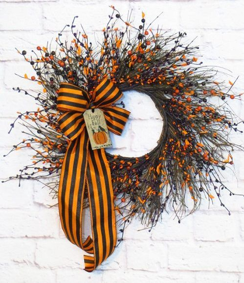 How to Make a Halloween Grapevine Wreath. Try this tutorial for bringing the spirit of Halloween to your front door with cute and festive embellishments. Thanks to Etsy Shop 'Dazzlement' for letting us feature! #Halloween #wreath #ideas