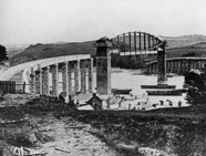 The Cornwall span in position and the Devon span still under construction of the Royal Albert Bridge, Saltash, 1858.