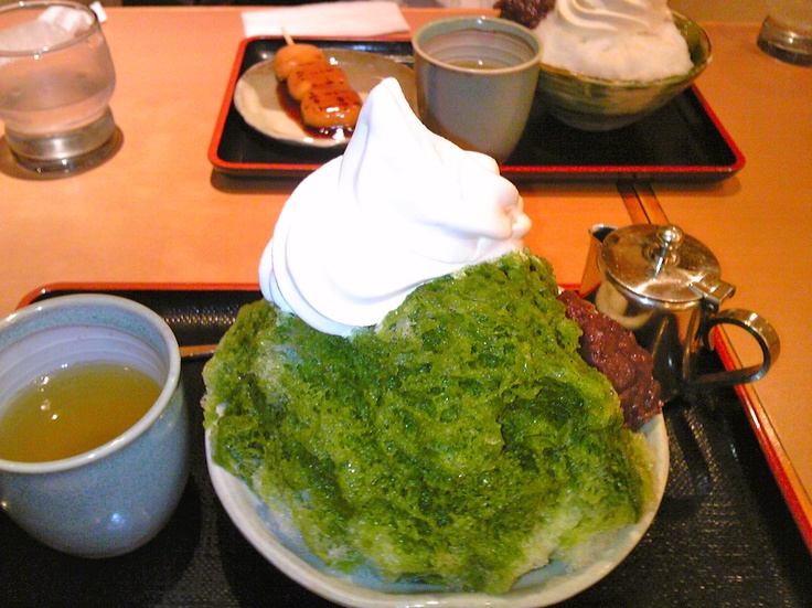 Shaved ice topped with Green tea flavored syrup.
