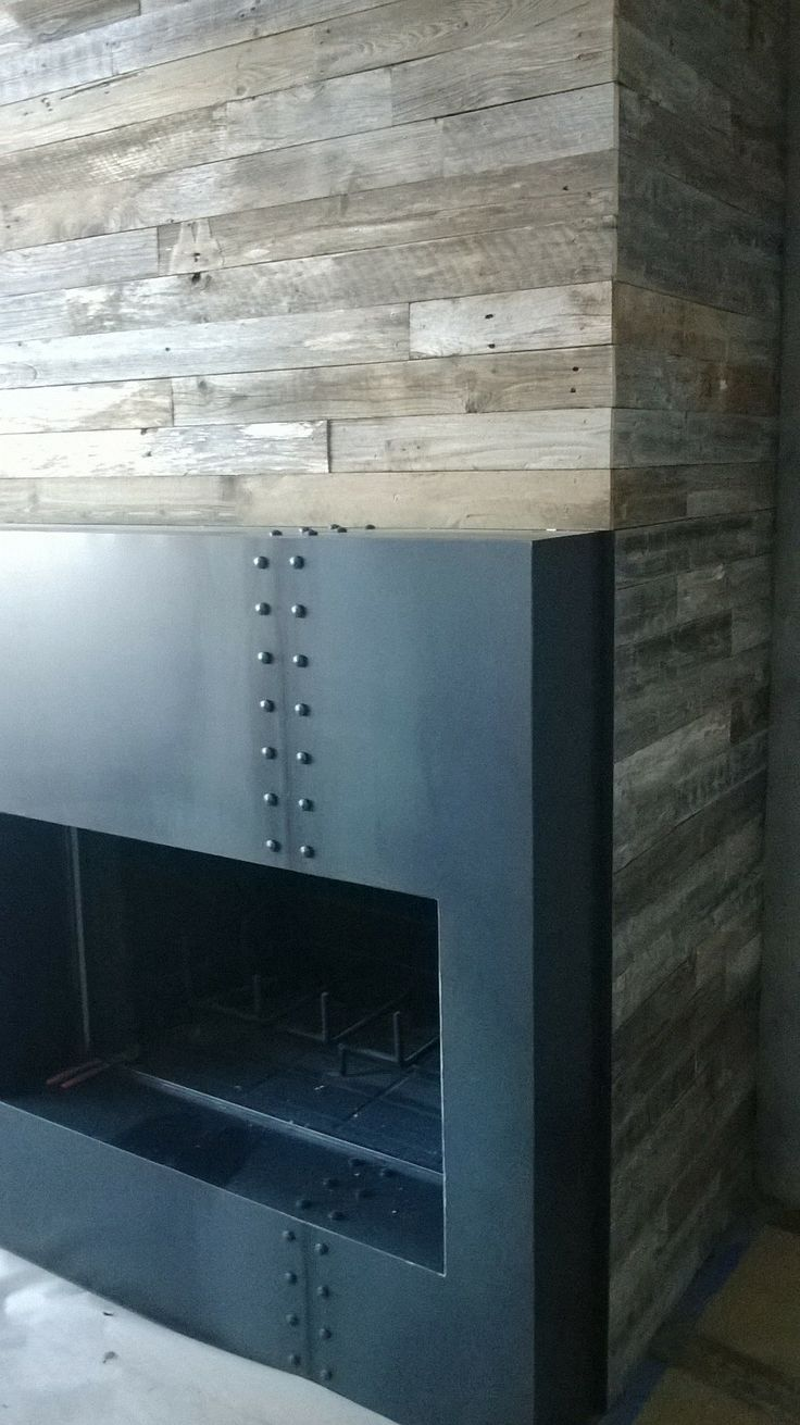 Custom Fireplace Surround And Reclaimed Wood Wall