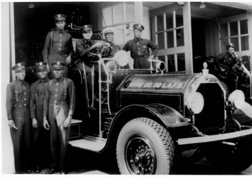 Firemen of Engine Company No. 30 Los Angeles Fire Department (LAFD) pose around a firetruck, circa 1931-1935 :: Dunbar Economic Development Corporation Collection, 1880-1986