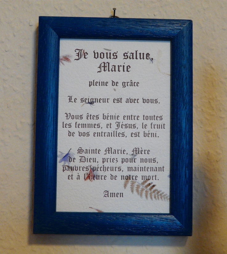 Je vous salue, Marie.  Hail Mary in French. Purchased in Paris in a Catholic store. Photo by Leslie Anneliese.
