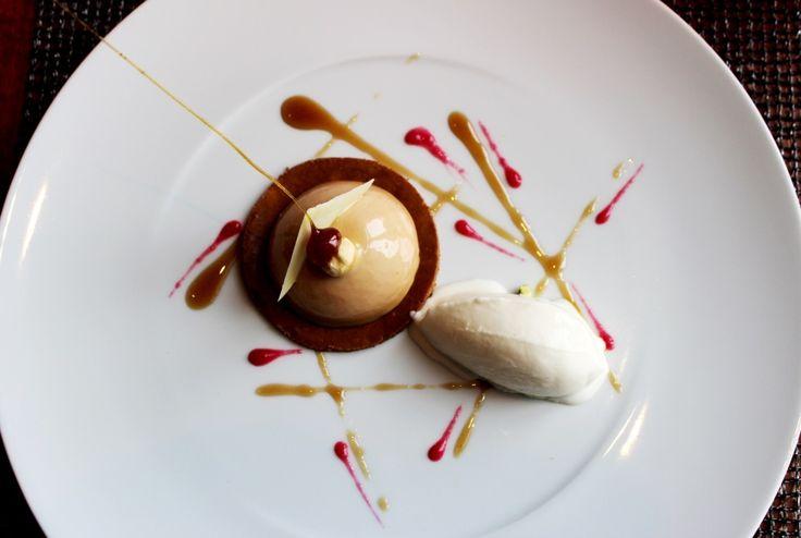 Pumpkin cheesecake glazed with Gianduia chocolate and yoghurt ice cream.