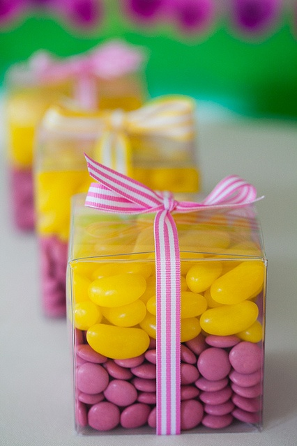 Party favours...jelly beans in clear boxes with ribbon.