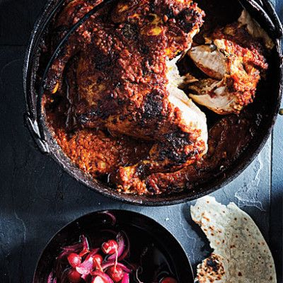Spatchcock chicken in a tomato vindaloo potjie with radish pickle