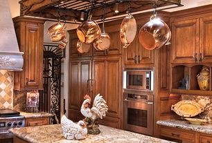 Mediterranean Kitchen with Granite countertop, Paint 1, All-Clad Copper Clad 10-Piece Cookware Set