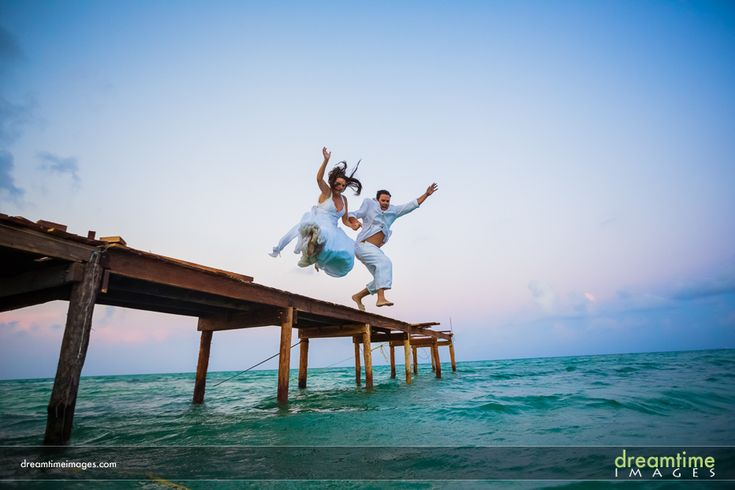 Bride and groom jumping off the pier during a TTD session at a Isla de la Pasión wedding. http://dreamtimeimages.com/blog/passion-island-wedding-photography-isla-del-passion-mexico-kelly-jason/