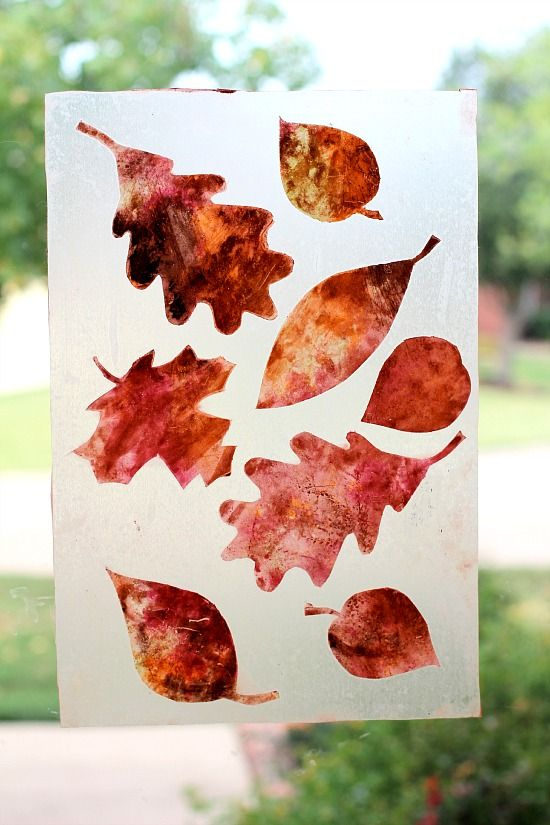 Make these beautiful fall themed suncatchers using powdered tempera paint, Contact paper, and a stencil.