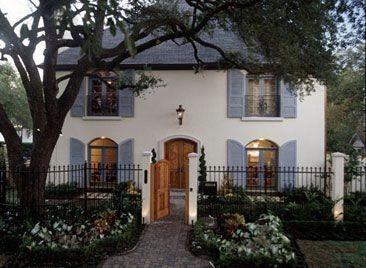 cream exterior teal shutters wood door Casa