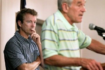 Rand Paul listens to his father speak at a 2011 campaign stop in Cedar Rapids, Iowa