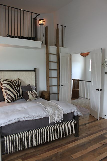 What a great idea!  Two guest rooms in one!  Kids up top where there are two twin beds, and mom and dad on the bed at the bottom.  I love that this room can sleep a whole family with plenty space for everyone.