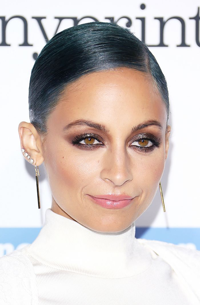 Nicole Richie dons a shimmery, chocolate smoky eye and slick of nude lip gloss with a deep side part and low bun.