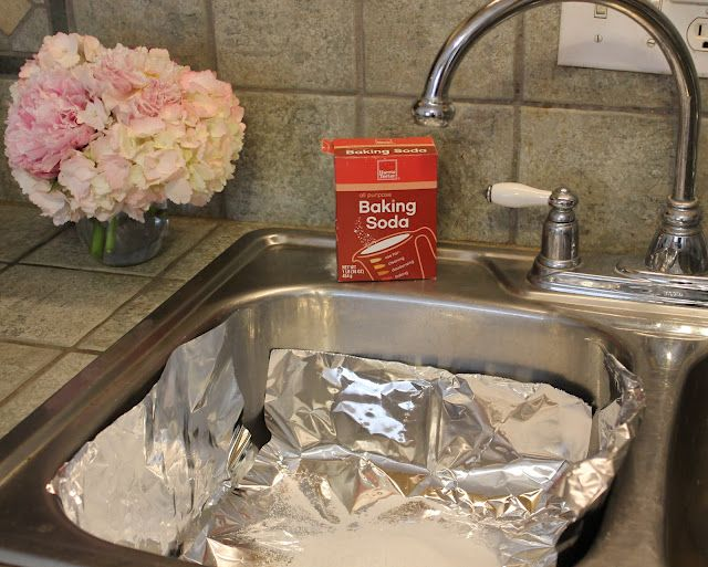 Remove tarnish from your silver using 1/2 cup baking soda, 1/2 cup salt, aluminum foil, and almost boiling water.