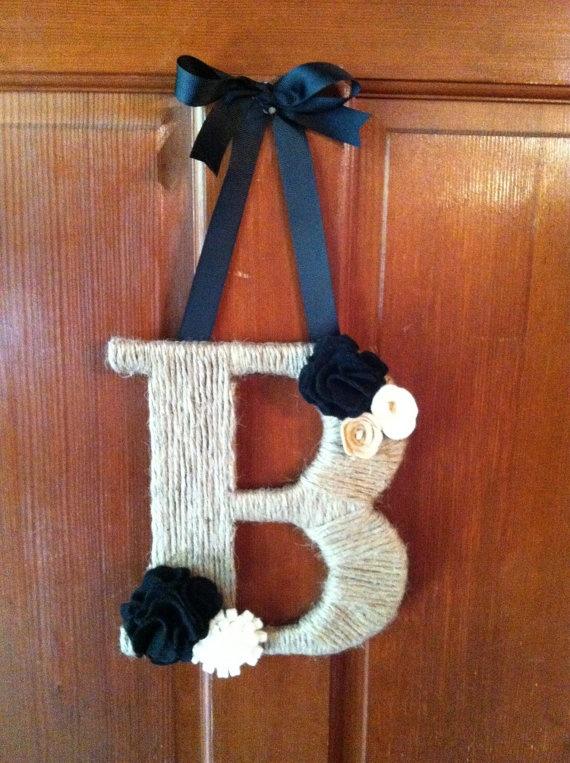 Initial Door Hanger. $25.00...easily DIY with wooden letter from Michael's