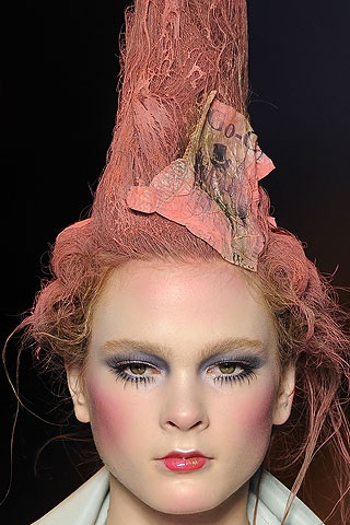 9. John Galiano's pink hair on runway tall and full much like the fontage of the 17th Century