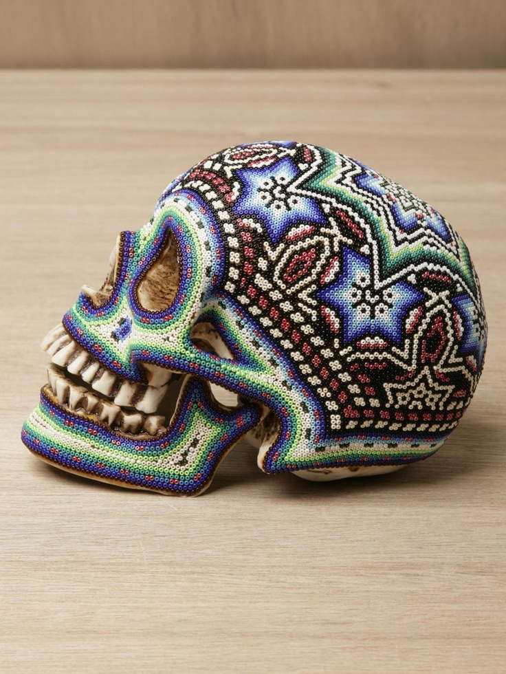 Beaded skull by the Huichol people of Mexico
