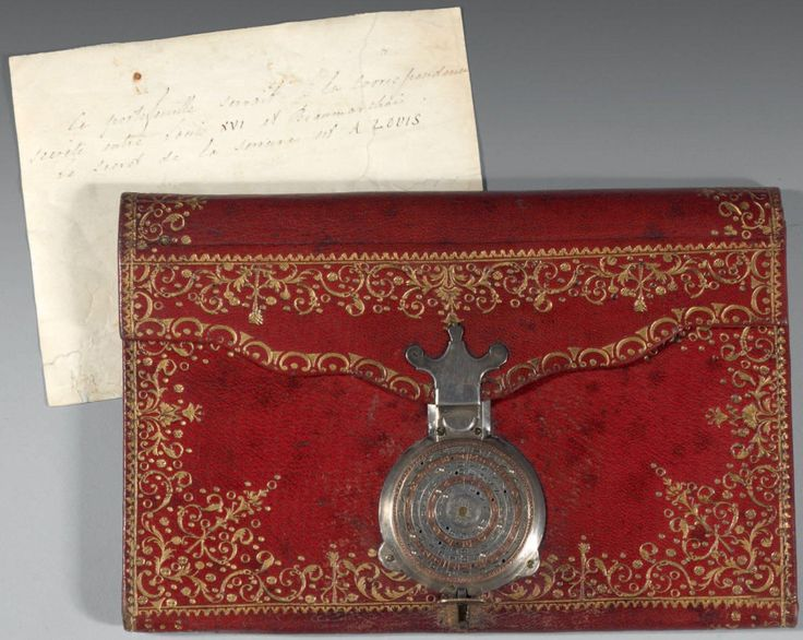 "Wallet belonging to Louis XVI, used for secret correspondence with secret agent Beaumarchais. Red morocco leather, gilt shackled foliage; inside covered with green silk. Combination lock in white and pink gold, composed of six circular dials engraved with letters. To open, align the letters ""A - L - O - U - I - S"" from the center. Beaumarchais oversaw covert supply of arms and financial assistance before France's formal entry into the American War of Independence in 1778."