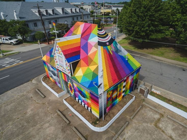This abandoned house was transformed into a floor-to-roof rainbow masterpiece.