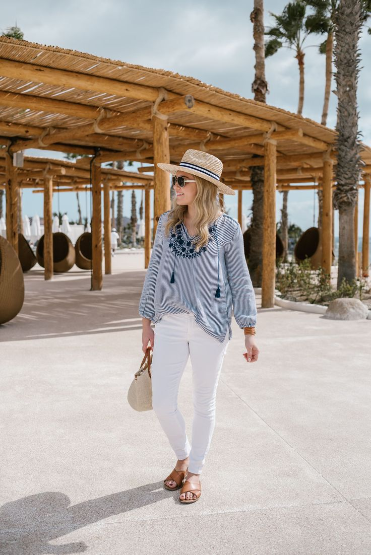 Lifestyle blogger Bows & Sequins styling a blue and white outfit from Old Navy on the beach in Cabo.
