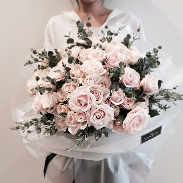 Bouquet/ARRANGEMENT:   TWO Dozen Roses + Branches of Eucalyptus + Wrap in White Tissue Paper OR ADD and Place into a Glossy Black Vase.