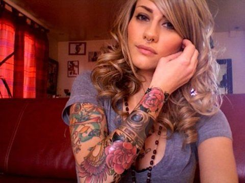 She has a nice sleeve. She still looks feminine and soft.