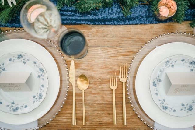 modern gold flatware rental navy blue sequin table runner