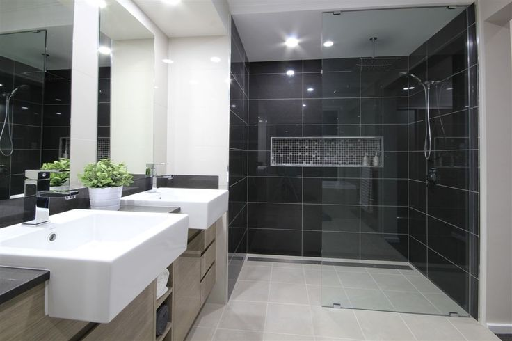 The Daintree Cove Display by Marksman Homes http://marksmanhomes.com.au/ #weeklyhometrends #marksmanhomes #newhome #design #styling #monochrome #colourpalette #blacktiles #contrast #australianliving #bathroom #caroma #doublebasins #interiordesign