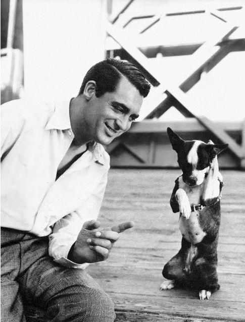 "Cary Grant with his co-star ""Squeezit"" on the set of their film ""When You're in Love"" (1937)."