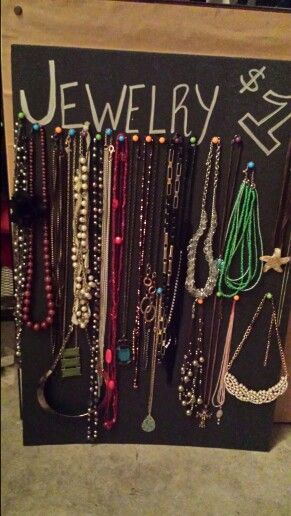 Yard sale display for jewelry! Just get a foam poster board and push pins! It's so easy!