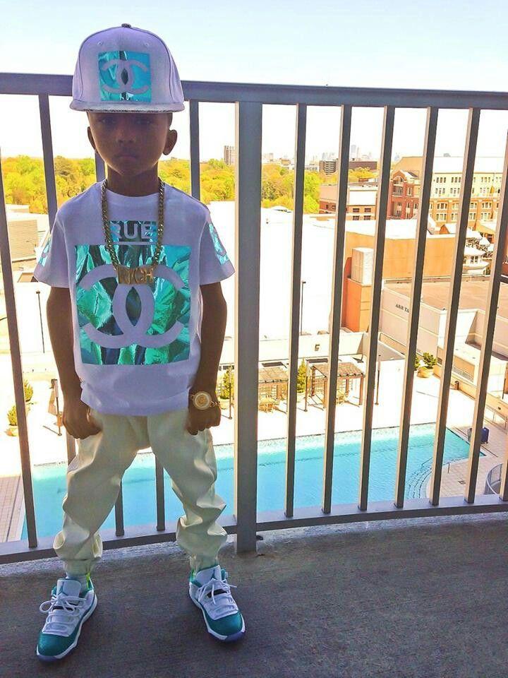 Waw! kidd got swag!! i want tht shirt n snapback he's wearin the shoes too