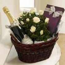 Luxury Basket - With House Champagne  A luxury basket containing a flowering plant, a box of delicious chocolates and a bottle of our House Champagne.    You could also choose to upgrade to one of our Premium Champagnes, or alternatively send a bottle of red or white wine instead? See below for details of these products.