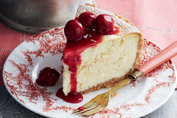 A sour cherry sauce adds colour to a traditional baked cheesecake.