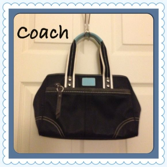 "HOST PICK 10/24 Coach purse Authentic Coach purse.  Black with white straps and light blue leather accents. Approximate measurements: 11"" L x 7"" H x 4"" W. Shoulder strap is about a 6"" drop from shoulder. The purse has leather accents. Zippered pocket on outside of purse as well as zippered closure to main compartment. This is a ""pre-loved"" purse that was well taken care of. There is a small ink mark on the blue label (see photo). It is being sold for a great price and it is still beautiful…"