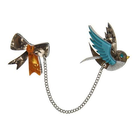 """Erstwilder Limited Edition Robin's Ribbon Brooch. """"The invitation said not to bring a thing. but this little robin doesn't go anywhere without her ribbon. Rock on Robin! """""""