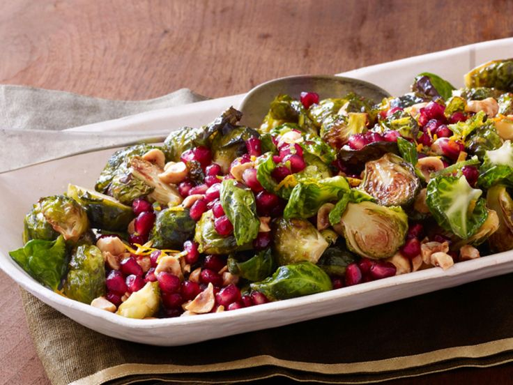 Roasted Brussels Sprouts With Pomegranate and Hazelnuts recipe from Bobby Flay via Food Network