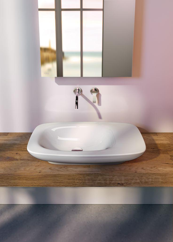 IMPRONTA 75X45 BY DORIANA E MASSIMILIANO FUKSAS  Il lavabo da appoggio è caratterizzato da un morbido catino asimmetrico e prevede l'installazione della rubinetteria da piano o da parete . Nel catalogo INOVA sono disponibili due specchi retroilluminati e mensole specifiche in finitura inox e rovere.