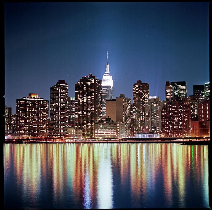 NYC. Reflection of New York Skyline at night.  Was looking t it jut a few days ago,  So pretty.  The new Towers are so great!