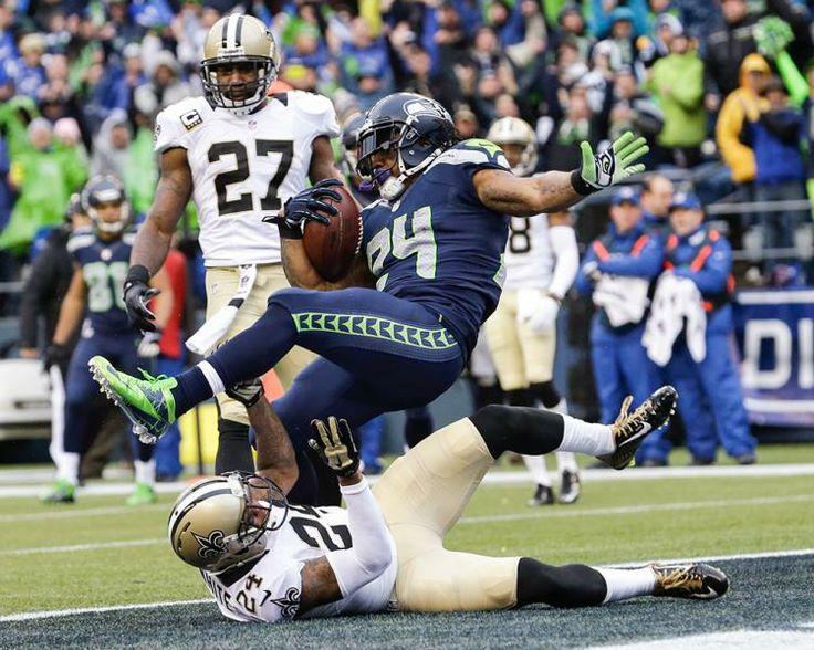 Seattle Seahawks running back Marshawn Lynch, top, scores past New Orleans Saints cornerback Corey White (24) for a 15-yard touchdown. (Elaine Thompson/AP)