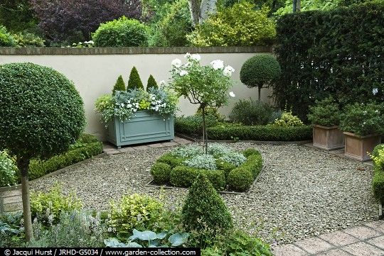 I would have replaced the rectangular planter with a water feature of a similar size.  See Capital Garden Products.