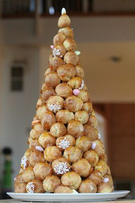 A croquembouche is a tower of cream puffs held together with caramel. In France it is the traditional cake for weddings, baptisms or commu...