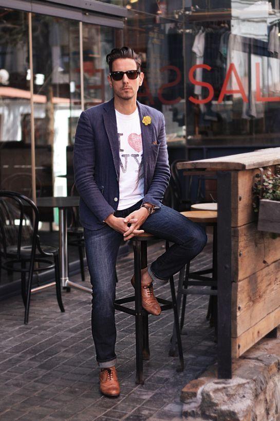 Wear a navy blue cotton blazer and navy blue jeans if you're going for a neat, stylish look. Dress up your getup with brown leather oxford shoes.   Shop this look on Lookastic: https://lookastic.com/men/looks/blazer-crew-neck-t-shirt-jeans/17956   — Yellow Floral Lapel Pin  — White Print Crew-neck T-shirt  — Navy Cotton Blazer  — Navy Jeans  — Brown Leather Oxford Shoes