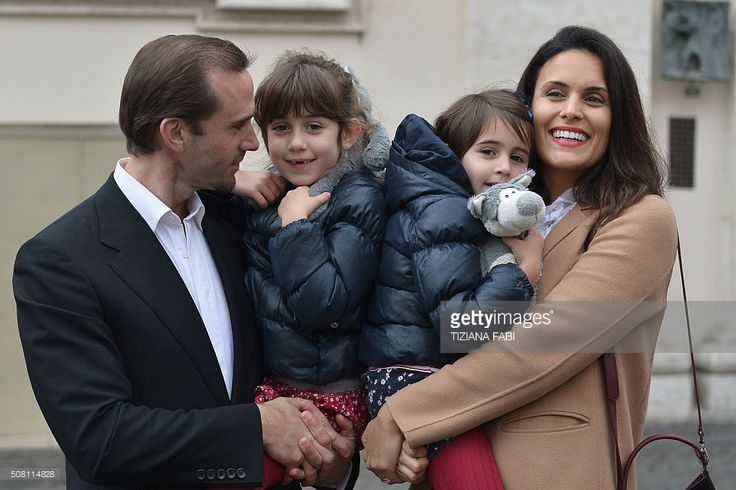 British actor Joseph Fiennes poses with his wife Maria Dolores Dieguez and their children in St Peter's square before Pope Francis weekly general audience on February 3, 2016 at the Vatican. Joseph Fiennes is in Rome today to promote the release of the biblical US movie 'Risen' directed by Kevin Reynolds.