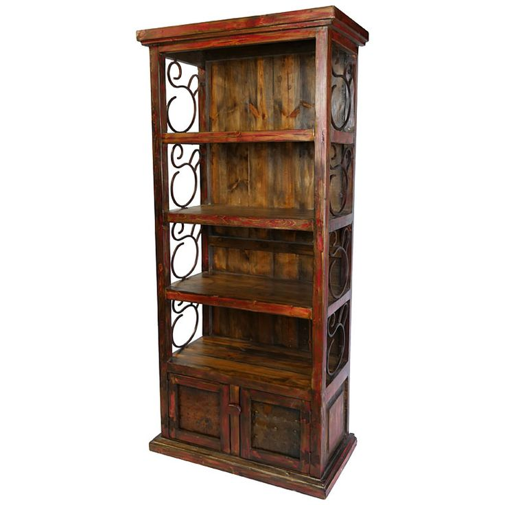 """Rustic Red Painted Wood Book Shelf with Iron Scrolls and Iron Panel Doors. This rustic red bookshelf with scroll iron work sides and lower storage cabinet is the perfect match for any southwest or Spanish Colonial style decor. 37"""" w x 19.25"""" d x 79.75"""" h"""